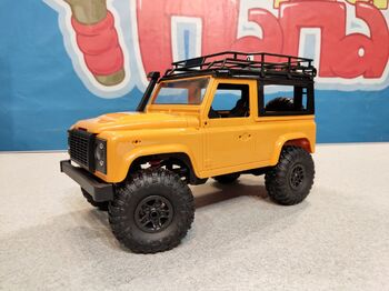 Радиоуправляемый краулер Land Rover Defender 90 1/12 4WD 2.4G желтый